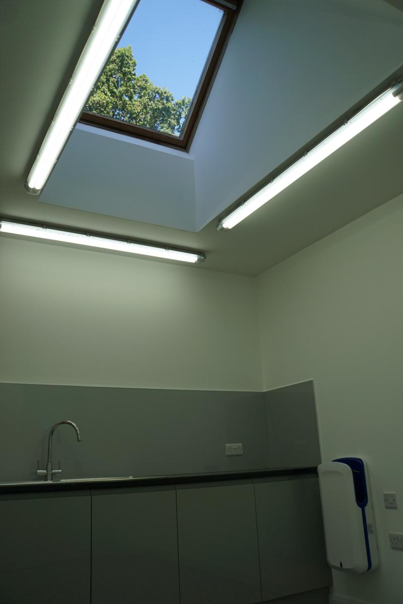 Inside the workshop. The skylight. Workshop, sink, and hand dryer.