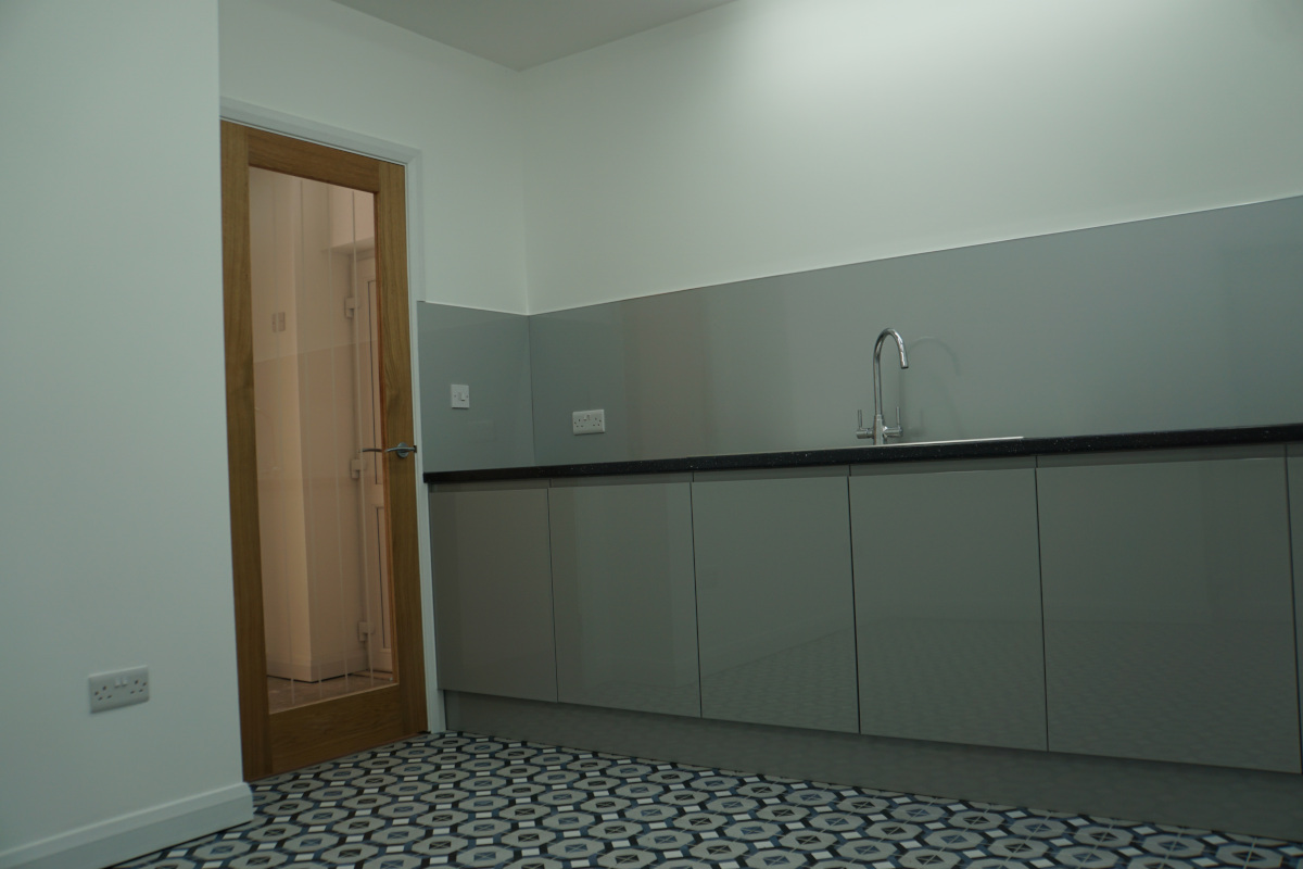Inside the workshop. Sink, worktop, door.